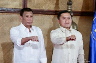 "(File photo) President Rodrigo Roa Duterte strikes his signature pose with Senator Christopher Lawrence ""Bong"" Go during the latter's oath-taking ceremony at the Malacañan Palace on June 27, 2019. RICHARD MADELO/PRESIDENTIAL PHOTO"