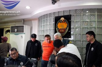Jose Adrian Dera, a co-accused in the drug-related cases filed against Senator Leila de Lima, faces the media on Friday, Aug. 16, following his arrest in Pampanga. /Moira Encina/Eagle News/
