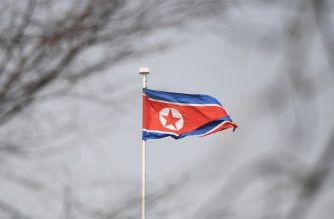 The North Korean flag flies above the North Korean embassy in Beijing on March 9, 2018. - US President Donald Trump agreed to a historic first meeting with North Korean leader Kim Jong Un in a stunning development in America's high-stakes nuclear standoff with North Korea. (Photo by GREG BAKER / AFP)