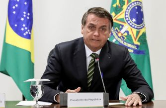 """Handout picture released by the Brazilian Presidency showing Brazilian President Jair Bolsonaro during a meeting with governors of the Amazon region at Planalto Palace in Brasilia on August 27, 2019. - Bolsonaro and governors discussed solutions to combat the exponential growth of the Amazon forest fires. (Photo by MARCOS CORREA / BRAZILIAN PRESIDENCY / AFP) / RESTRICTED TO EDITORIAL USE - MANDATORY CREDIT """"AFP PHOTO / BRAZILIAN PRESIDENCY / MARCOS CORREA"""" - NO MARKETING NO ADVERTISING CAMPAIGNS - DISTRIBUTED AS A SERVICE TO CLIENTS"""