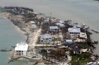 """In this aerial image courtesy of a US Coast Guard Elizabeth City C-130 aircraft crew, homes and piers in the Bahamas lie damaged on September 3, 2019, after Hurricane Dorian. - Dorian churned towards the United States Wednesday after leaving seven dead in the Bahamas, where the prime minister said terrified residents had endured """"days of horror"""" at the hands of the monster storm. Announcing the updated death toll, Prime Minister Hubert Minnis warned the number would rise as he called Dorian """"one of the greatest national crises in our country's history."""" (Photo by Adam Stanton / US Coast Guard / AFP) / RESTRICTED TO EDITORIAL USE - MANDATORY CREDIT """"AFP PHOTO / US Coast Guard / Petty Officer 2nd Class Adam Stanton"""" - NO MARKETING NO ADVERTISING CAMPAIGNS - DISTRIBUTED AS A SERVICE TO CLIENTS"""