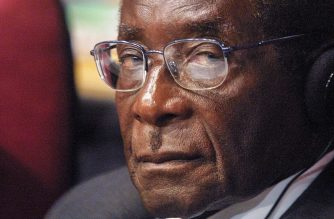 (FILES) In this file photo taken on September 2, 2002 Zimbabwean President Robert Mugabe listens to speeches during a session of the World Summit on Sustainable Development (WSSD) at Sandton convention center in Johannesburg. - Robert Mugabe, who led Zimbabwe with an iron fist from 1980 to 2017, has died aged 95, the country's president announced on September 6, 2019. (Photo by Anna ZIEMINSKI / AFP)