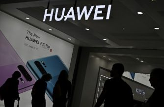 Visitors walk past the booth of Huawei promoting its P30 Pro smartphone at the international electronics and innovation fair IFA in Berlin on September 6, 2019. - Exhibitors from more than 100 countries will be presenting their latest products during the fair running from September 6 to 11, 2019. (Photo by Tobias SCHWARZ / AFP)