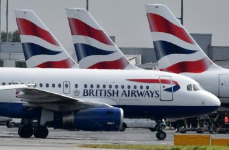 (FILES) In this file photo taken on May 03, 2019 British Airways passenger aircraft are pictured at London Heathrow Airport, west of London. - British Airways faced its first global strike by pilots on Monday September 9, and the possibility of almost all its flights being grounded for two days. (Photo by BEN STANSALL / AFP)