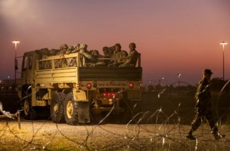 (FILES) In this file photo taken on November 06, 2018 US Army troops enter a compound where the military is erecting an encampment near the US-Mexico border crossing at Donna, Texas. - The US Defense Department said September 10, 2019, that it would keep up to 5,500 troops deployed at the Mexican border for the coming year to help fight illegal immigration. (Photo by Andrew Cullen / AFP)