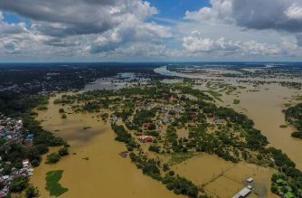 "This aerial picture shows a flooded area in Thailand's northeastern  province of Ubon Ratchathani on September 14, 2019. - Floods in northeastern Thailand have inundated homes, roads and bridges, leaving over 23,000 people in evacuation shelters on September 14, as anger grows over the government's ""slow"" emergency response. (Photo by Krit Phromsakla Na SAKOLNAKORN / THAI NEWS PIX / AFP)"