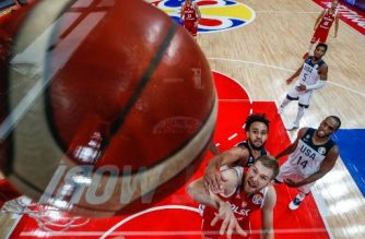 Poland's Michal Sokolowski (bottom) and Derrick White of the US jump for the ball during the Basketball World Cup classification game between US and Poland in Beijing on September 14, 2019. (Photo by ROMAN PILIPEY / POOL / AFP)
