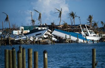 (FILES) In this file photo taken on September 11, 2019 destroyed boats are pushed up against the pier in the aftermath of Hurricane Dorian in Treasure Cay on Abaco island, Bahamas,. - Tropical Storm Humberto lashed the Bahamas with rain and wind on September 14, possibly slowing down relief efforts in the wake of the devastation wrought less than two weeks ago by Hurricane Dorian. The US National Hurricane Center said the center of the storm, packing maximum sustained winds of 60 miles (95 kilometers) per hour, was passing Saturday evening about 85 miles north of Great Abaco Island, one of the areas hardest hit by Dorian. (Photo by Andrew CABALLERO-REYNOLDS / AFP)