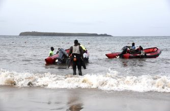 Senegalese emergency workers prepare their boats to leave for a reascue and search mission on a beach of Dakar, near the Madeleine islands, on September 17, 2019, after at least four people died and three were missing after a boat carrying dozens of tourists capsized under heavy storms. - The boat was carrying 24 Senegalese nationals, six French people, two Germans, two Swedes and one person from Guinea-Bissau, when it turned over in driving rain and a heavy swell, fire department chief Papa Angel Michel Diatta said. The identities and nationalities of the victims are not yet known. The boat was heading for the Madeleine islands, site of an offshore national park popular with tourists who travel from Dakar, coastal capital of the West African country. Emergency services continued to look for those missing on September 17. (Photo by Seyllou / AFP)