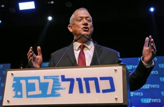Benny Gantz, leader and candidate of the Israel Resilience party that is part of the Blue and White (Kahol Lavan) political alliance, addresses supporters at the alliance's campaign headquarters in the Israeli coastal city of Tel Aviv early on September 18, 2019. - Israeli Prime Minister Benjamin Netanyahu and his main challenger Benny Gantz were locked in a tight race in the country's general election after polls closed, exit surveys showed, raising the possibility of another deadlock. Three separate exit polls carried by Israeli television stations showed Netanyahu's right-wing Likud and Gantz's centrist Blue and White alliance with between 31 and 34 parliament seats each out of 120. (Photo by GALI TIBBON / AFP)