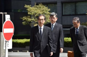Ichiro Takekuro (L), former vice president of Tokyo Electric Power Company (TEPCO), the firm that operated the Fukushima plant, arrives at the Tokyo District Court in Tokyo on September 19, 2019, as three former executives from TEPCO face up to five years in prison if convicted. - More than eight years after the Fukushima nuclear disaster, a Japanese court was expected to rule on September 19 on the only criminal prosecution stemming from the worst nuclear accident in decades. (Photo by Kazuhiro NOGI / AFP)