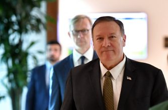 US Secretary of State Mike Pompeo and US special representative on Iran Brian Hook (background) arrive to al-Bateen Air Base in Abu Dhabi on September 19, 2019. (Photo by MANDEL NGAN / POOL / AFP)