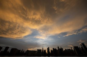 (FILES) In this file photo taken on July 21, 2019 the sun sets behind the skyline of midtown Manhattan in New York City. - A damning new UN report published September 22, 2019 said the world is falling badly behind in the race to avert climate disaster as a result of runaway warming, with the five-year period ending 2019 set to be the hottest ever. It comes ahead of a major UN climate summit Monday that will be attended by more than 60 world leaders, as Secretary-General Antonio Guterres pushes for countries to increase their greenhouse gas reduction targets. (Photo by Johannes EISELE / AFP)
