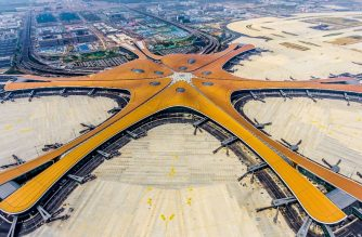 (FILES) This file photo taken on June 28, 2019 shows the terminal of the new Beijing Daxing International Airport. - A futuristic new airport in Beijing, which is expected to become one of the busiest in the world, was opened by President Xi Jinping on September 25, 2019. (Photo by STR / AFP) / China OUT