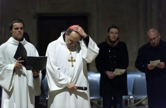 "Roman Catholic Cardinal, Archbishop of Lyon, Philippe Barbarin (2ndL) attends a Good Friday mass on March 25, 2016 in Saint-Jean cathedral in Lyon, central eastern France. - Barbarin, accused of covering up the sexual abuse of children by priests apologised to victims during a mass on March 23, according to the website of his diocese. Barbarin, quoting Pope Francis, said on March 23 he was ""obliged to assume all the evil committed by some priests and personally apologise for the damage they have caused by sexually abusing children."" (Photo by ROMAIN LAFABREGUE / AFP)"