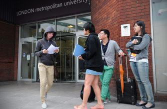 Foreign students and advisors are pictured outside a campus of the London Metropolitan University in London, on August 30, 2012. Thousands of overseas students on Thursday faced possible deportation from Britain after the government stripped a London university of its right to sponsor their visas. Amid alarm at the potential damage to the foreign student market in Britain -- worth an estimated £14 billion (17.7 billion euros, $22.2 billion) -- the government rushed to reassure foreign students that it was an isolated case.  AFP PHOTO / CARL COURT (Photo by CARL COURT / AFP)
