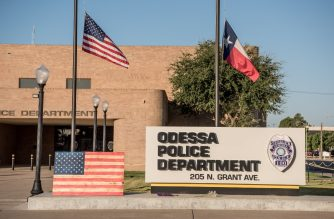 ODESSA, TX - SEPTEMBER 2: Flowers lay in front of the Odessa Police Department two days after a mass shooting claimed the lives of seven people, on September 2, 2019 in Odessa, Texas. Officials say the suspect Seth Ator, 36, is dead after he killed 7 people and injured 22 in the mass shooting.   Cengiz Yar/Getty Images/AFP