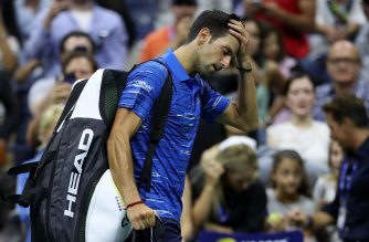 NEW YORK, NEW YORK - SEPTEMBER 01: Novak Djokovic of Serbia reacts as he walks off court after retiring due to a shoulder injury during his Men's Singles fourth round match against Stan Wawrinka of Switzerland on day seven of the 2019 US Open at the USTA Billie Jean King National Tennis Center on September 01, 2019 in Queens borough of New York City.   Matthew Stockman/Getty Images/AFP