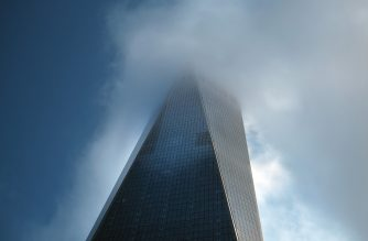 NEW YORK, NEW YORK - SEPTEMBER 11: One World Trade Center, also known as the Freedom Tower, is shrouded in a cloud above the National September 11 Memorial during a morning commemoration ceremony for the victims of the terrorist attacks Eighteen years after the day on September 11, 2019 in New York City. Throughout the country services are being held to remember the 2,977 people who were killed in New York, the Pentagon and in a field in rural Pennsylvania.   Spencer Platt/Getty Images/AFP