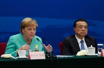Chancellor of Germany Angela Merkel (L) gives a speech next to Chinese Premier Li Keqiang during the German-Chinese Dialogue Forum at the Great Hall of the People in Beijing on September 6, 2019. (Photo by Andrea Verdelli / POOL / AFP)