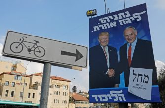 An Israeli election billboard for the Likud party, showing US President Donald Trump (L) shaking hands with Likud chairman and Prime Minister Benjamin Netanyahu hangs on a street in Jerusalem on September 16, 2019. (Photo by AHMAD GHARABLI / AFP)