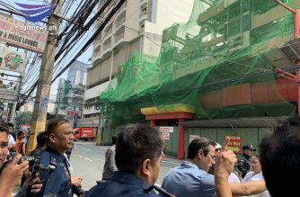Manila Mayor Isko Moreno rushed to the site where a portion of the Sogo hotel in Manila collapsed on Monday, Sept. 23./Moira Encina/Eagle News/