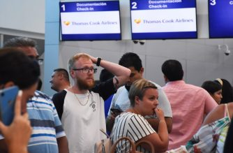 Passengers queue at the closed Thomas Cook check-in desk at the International Airport in Cancun, Mexico, on September 23, 2019. (Photo by ELIZABETH RUIZ / AFP)