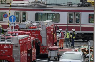 Fire trucks and rescue personnel gather at the scene where a train and a truck collided at a crossing in Yokohama, Kanagawa Prefecture on September 5, 2019.  (Photo by Kazuhiro Nogi / AFP)