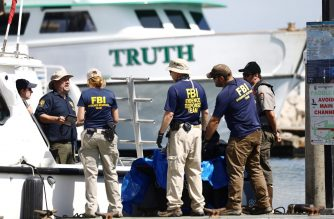 Members of the FBI Evidence Response Team and other officials work in front of the ship Truth, a sister ship of the diving ship Conception, on September 3, 2019 in Santa Barbara, California.  (Mario Tama/Getty Images/AFP)