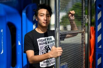 In this picture taken on August 20, 2019, Jimmy Sham, convener of the Civil Human Rights Front (CHRF), poses during an interview with AFP in Hong Kong. - Armed with smartphones and imagination, a handful of fellow volunteers from the Civil Human Rights Front (CHRF) are the driving force behind pulling huge numbers of people to the city's streets in Hong Kong's biggest political rallies in decades. (Photo by Anthony WALLACE / AFP) / TO GO WITH HongKong-politics-unrest-protest-organisers,FOCUS by Emma Clark and Yan Zhao