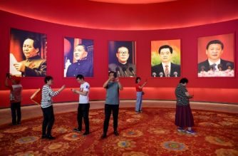 A group of people take pictures in front of portraits of (L to R) late Chinese chairman Mao Zedong and former Chinese leaders Deng Xiaoping, Jiang Zemin, Hu Jintao and current president Xi Jinping at an exhibition marking the country's achievements over the past 70 years, ahead of the 70th anniversary of the founding of the People's Republic of China, in Beijing on September 26, 2019. (Photo by WANG ZHAO / AFP)