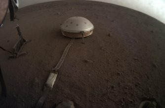 "In this handout picture provided by NASA,and taken on April 25, 2019 clouds drift over the dome-covered seismometer, known as SEIS, belonging to NASA's InSight lander, on Mars. - NASA on October 1, 2019 released two audio clips of seismic activity on Mars after an ""exquisitely sensitive"" detector was set down on the planet's surface late last year. The quakes, far too quiet to be picked up by the human ear, were recorded by the Seismic Experiment for Interior Structure (SEIS) in May and July. (Photo by Handout / Nasa/JPL-Caltech / AFP)"