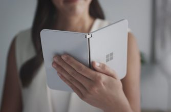 "This handout photo obtained October 2, 2019 courtesy of Microsoft shows a woman looking at a new dual-screen device Surface Duo. - Microsoft on October 2, 2019 unveiled Surface tablet computers with twin-screens that opened like books, and a notepad-sized version that put it back in the smartphone game. Surface Duo was touted as the first device in the line-up to fit into a pants pocket, with two ""paper-thin"" 5.6-inch screens that unfold and work in harmony with a specially tailored Windows operating system. Duo handled telephone calls, as well as applications designed to run on Google-backed Android mobile software, which powers most of the world's smartphones.""You are going to talk about it as a phone, and I get that,"" Microsoft chief product officer Panos Panay said of Duo at a Surface event in New York City. (Photo by HO / Microsoft / AFP) / RESTRICTED TO EDITORIAL USE - MANDATORY CREDIT ""AFP PHOTO / MICROSOFT/HANDOUT"" - NO MARKETING - NO ADVERTISING CAMPAIGNS - DISTRIBUTED AS A SERVICE TO CLIENTS"