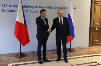 Russian President Vladimir Putin (R) shakes hands with Philippine's President Rodrigo Duterte prior to their meeting at the Valdai Discussion Club in Sochi on October 3, 2019. (Photo by Mikhail KLIMENTYEV / Sputnik / AFP)