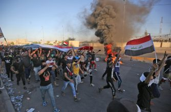 "Iraqi protesters take part in a demonstration against state corruption, failing public services, and unemployment, in the Iraqi capital Baghdad's central Khellani Square on October 4, 2019. - Iraqi security forces said ""unidentified snipers"" killed four people across the capital Baghdad today, the fourth day of violent anti-government protests. (Photo by AHMAD AL-RUBAYE / AFP)"