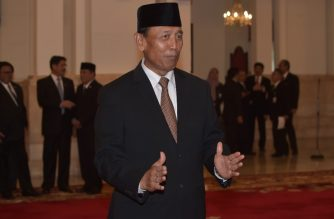 "(FILES) This file photo taken on July 27, 2016 shows then-newly appointed Indonesian Security Minister Wiranto posing for photographers prior to an inauguration ceremony at the presidential palace in Jakarta. - Indonesia's chief security minister Wiranto suffered ""two deep wounds"" in his stomach after he was stabbed by a suspected militant on October 10, 2019, according to police and a hospital spokesman, adding that a local police chief was also injured. (Photo by ADEK BERRY / AFP)"