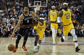 Spencer Dinwiddie of the Brooklyn Nets (L) drives the ball while is guarded by Rajon Rondo (R) of the Los Angeles Lakers during the National Basketball Association (NBA) pre-season match between the LA Lakers and Brooklyn Nets at the Mercedes Benz Arena in Shanghai on October 10, 2019. (Photo by HECTOR RETAMAL / AFP)