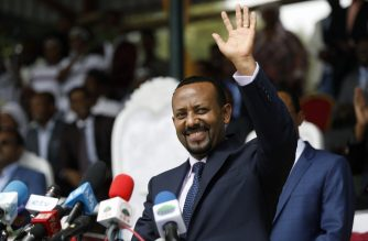 (FILES) In this file photo taken on April 11, 2018 New Ethiopian Prime Minister Abiy Ahmed waves during his rally in Ambo, about 120km west of Addis Ababa, Ethiopia. - Ethiopian Prime Minister Abiy Ahmed was awarded the Nobel Peace Prize for his efforts to resolve his country's conflict with bitter foe Eritrea, the Nobel Committee announced in Oslo on October 11, 2019 (Photo by Zacharias Abubeker / AFP)
