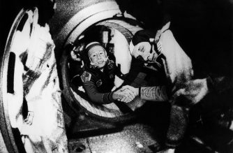(FILES) In this file photo taken on July 17, 1975, Commander of the Soviet crew of Soyuz, Alexei Leonov (L) and commander of the US crew of Apollo, Thomas Stafford (R), shake hands after the Apollo-Soyuz docking maneuvers. - Alexei Leonov, a Soviet-era cosmonaut who was the first man to conduct a spacewalk in 1965, died on October 11, 2019 in Moscow aged 85, his assistant said. (Photo by HO / NASA / AFP)