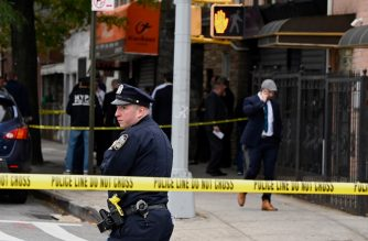 New York police officers secure a crime scene outside a club after a shooting in Brooklyn on October 12, 2019. - At least four people died and three were wounded in a shooting at a social club in New York eary Saturday, police said. No one has been arrested over the shooting, which took place in Brooklyn, and the motive and exact circumstances are not known, a New York police official told AFP. The local affiliate of ABC News described the place where the shooting took place as an after-hours club. (Photo by Johannes EISELE / AFP)
