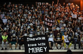 "Protesters shout slogans as they hold flyers at the Southorn Playground in Hong Kong on October 15, 2019, during a rally in support of NBA basketball Rockets general manager Daryl Morey and against comments made by Lakers superstar LeBron James. - US basketball superstar LeBron James on October 14, 2019, has sharply criticised a Houston Rockets executive for angering China with a tweet supporting protesters in Hong Kong, saying the executive was ""misinformed"" and should have kept his mouth shut. (Photo by Anthony WALLACE / AFP)"