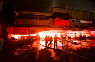 Firemen try to put out a fire inside a mall following a 6.4-magnitude quake in General Santos City, in southern island of Mindanao, on October 16, 2019. - A strong and shallow 6.4-magnitude quake hit the southern Philippines on October 16, the United States Geological Survey (USGS) said, sending hundreds rushing out of a shopping mall where local television said an elderly man was injured. (Photo by EDWIN ESPEJO / AFP)