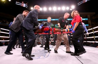 (FILES) In this file photo taken on October 12, 2019 Patrick Day is taken out of the ring after being knocked out in his Super-Welterweight bout against Charles Conwell at Wintrust Arena in Chicago, Illinois. - American boxer Patrick Day died October 16, 2019, after suffering a serious brain injury during his knockout defeat to Charles Conwell last weekend, promoter Lou DiBella said in a statement. (Photo by Dylan Buell / GETTY IMAGES NORTH AMERICA / AFP)