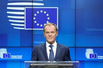European Council President Donald Tusk addresses media representatives at a press conference during a European Union Summit at European Union Headquarters in Brussels on October 18, 2019. (Photo by Aris OIKONOMOU / AFP)