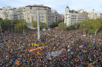 "People demonstrate in Barcelona, on October 18, 2019, on the day that separatists have called a general strike and a mass rally. - Spain's protest-hit northeast was gripped by a general strike today as thousands of ""freedom marchers"" converged on Barcelona for a mass show of dissent over the jailing of nine Catalan separatist leaders. (Photo by LLUIS GENE / AFP)"