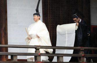 Japan's Emperor Naruhito (L) walks to Kashikodokoro sanctuary to report the proclamation of his ascension to the throne to sun goddess in the ancient royal dynasty during a ritual at the Imperial Palace in Tokyo on October 22, 2019. - Emperor Naruhito officially assumed his duties as emperor on May 1, 2019 a day after his father became the first Japanese monarch to abdicate in 200 years, but the transition was not complete until his new role was officially proclaimed in a series of events. (Photo by STR / Japan Pool via Jiji Press / AFP) / Japan OUT