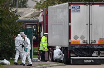 British Police forensics officers work on lorry, found to be containing 39 dead bodies, at Waterglade Industrial Park in Grays, east of London, on October 23, 2019. - Britain launched a major murder investigation after 39 bodies were found Wednesday in a truck from Bulgaria, as police tried to establish where the victims were originally from. All the victims were pronounced dead at the scene in an indusTrial park in Grays, east of London, triggering revulsion among politicians and once again putting the spotlight on the shadowy people trafficking business. (Photo by Ben STANSALL / AFP)