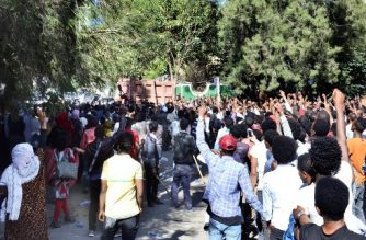 Supporters of Jawar Mohammed, a member of the Oromo ethnic group who has been a public critic of Abiy, gather outside his home in the Ethiopian capital, Addis Ababa after he accused security forces of trying to orchestrate an attack against him October 24, 2019. - A day after supporters of the high-profile opposition activist took to the streets, burning tyres and blocking roads following rumours of Jawar's mistreatment by state forces  where at least four people were killed and dozens injured in protests in Ethiopia against Nobel Peace Prize laureate and Prime Minister Abiy Ahmed, hospital and police sources said Thursday. (Photo by STRINGER / AFP)