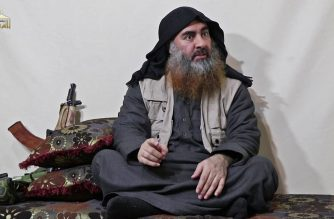 """(FILES) In this undated filer image grab taken from a video released by Al-Furqan media on April 29, 2019, the chief of the Islamic State group Abu Bakr al-Baghdadi purportedly appears for the first time in five years in a propaganda video in an undisclosed location. - Baghdadi was believed to be dead after a US military raid in Syria's Idlib region, US media reported early Sunday. Baghdadi may have killed himself with a suicide vest as US special operations forces attacked, media said citing multiple government sources. (Photo by - / AL-FURQAN MEDIA / AFP) / THIS PICTURE WAS MADE AVAILABLE BY A THIRD PARTY. AFP CAN NOT INDEPENDENTLY VERIFY THE AUTHENTICITY, LOCATION, DATE AND CONTENT OF THIS IMAGE. THIS PHOTO IS DISTRIBUTED EXACTLY AS RECEIVED BY AFP. RESTRICTED TO EDITORIAL USE - MANDATORY CREDIT """"AFP PHOTO / SOURCE / AL-FURQAN"""" - NO MARKETING - NO ADVERTISING CAMPAIGNS - DISTRIBUTED AS A SERVICE TO CLIENTS /"""