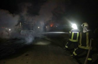 Firefighters extinguish the flames of a burning truck at the spot where Abu Hassan al-Muhajir, the Islamic State group's spokesman was reportedly killed in a raid in the northern Syrian village of Ayn al-Bayda near Jarablus on October 27, 2019. - The right-hand of Baghdadi and the spokesman for IS, was targeted in a coordinated operation between the Syrian Democratic Forces (SDF) intelligence and the US army, SDF chief Mazloum Abdi said on Twitter. (Photo by Aaref WATAD / AFP)